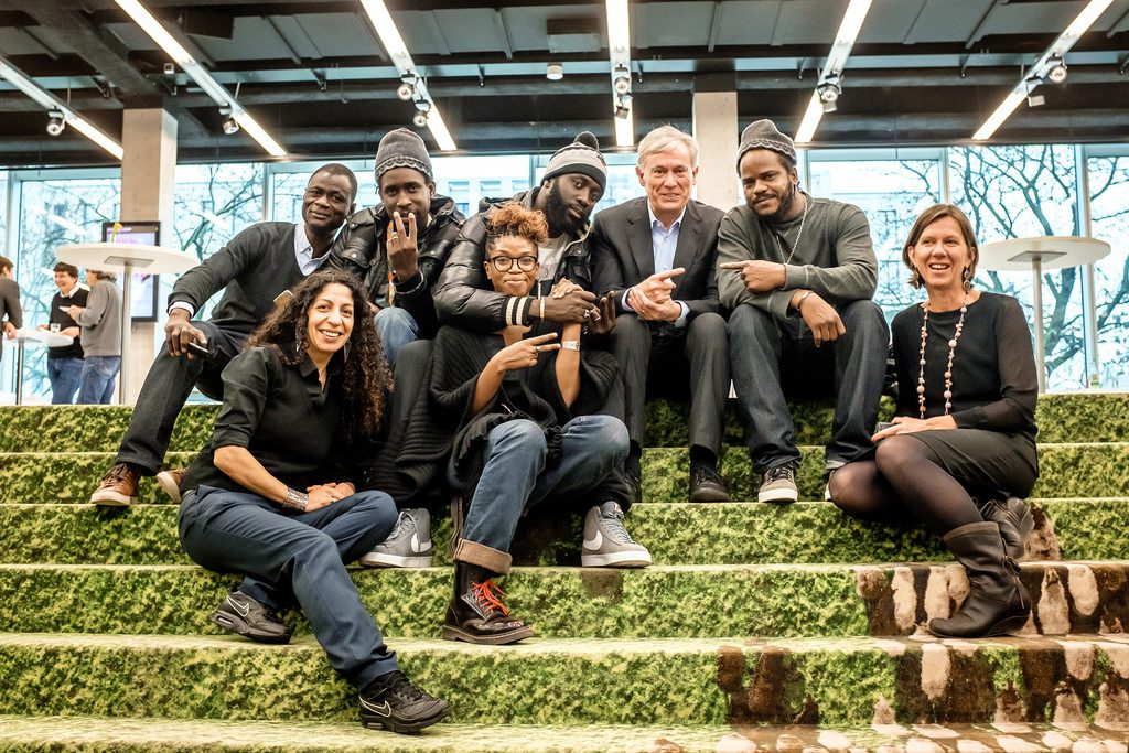 """Horst Köhler with director-filmmaker Rama Thiaw, Senegalese rap group 'Y'en a marre!' and others, Berlin, February 2016 (Andi Weiland, Heinrich Böll Foundation, creative commons license – """"share alike"""" 2.0 Generic (CC BY-SA 2.0), http://creativecommons.org/licenses/by-sa/2.0/deed.de)."""